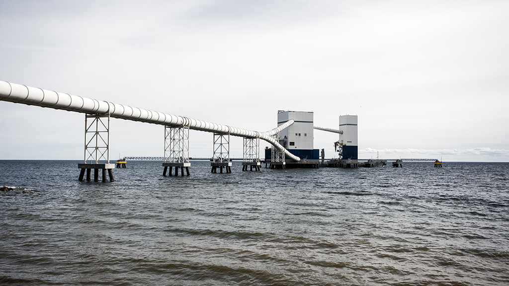 Conveyors in closed galleries carry finished cement to the marine terminal offshore.
